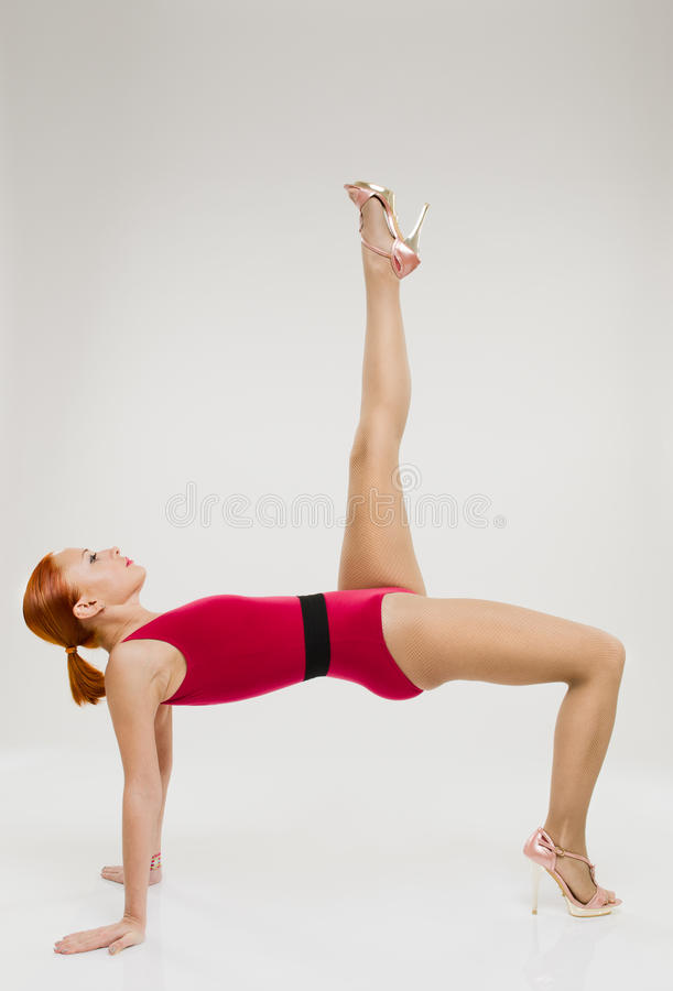 Beautiful Fitness Woman Performing Handstand Stock Photography