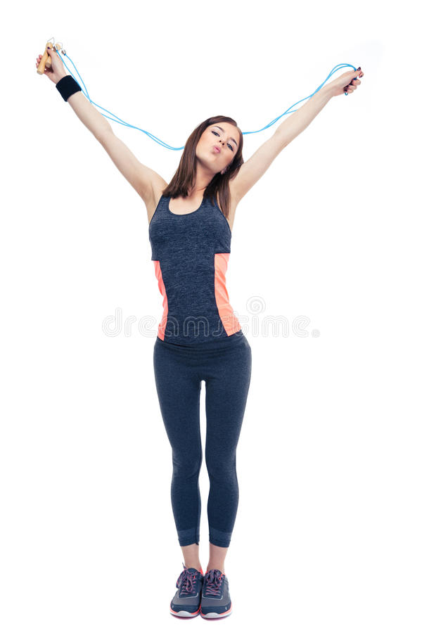 Beautiful fitness woman standing with skipping rope. Isolated on a white background. Looking at camera stock images