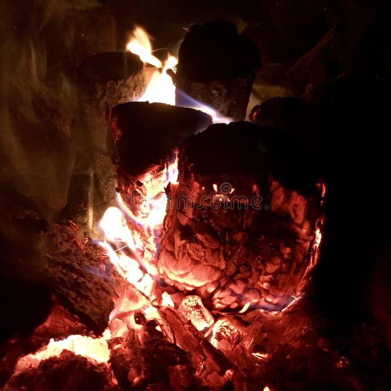 Beautiful flame brown wood dark black coal stock photo