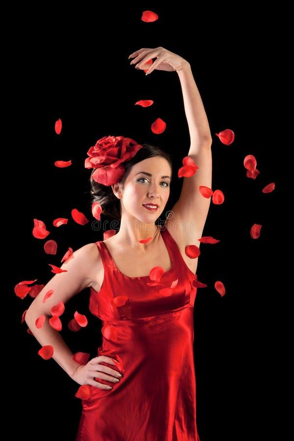 Beautiful flamenco girl with rose petals stock photos