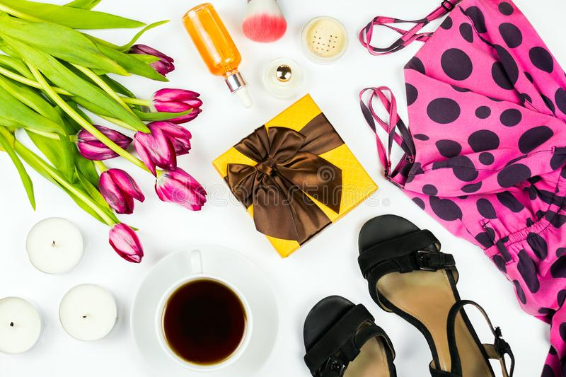 Beautiful flatlay with dotted dress, present, candles, flowers, cosmetics and other accessories stock images