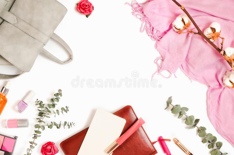 Beautiful flatlay frame arrangement with backpack, cosmetics, planner and other business and fashion feminine accessories royalty free stock images