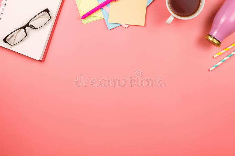 Beautiful flatlay with notebook, glasses, colorful note papers, cup of tea, bottle with juice or smoothie and straws. stock image