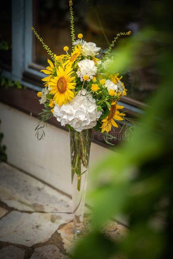 Beautiful floral arrangement or decoration for wedding or event. Sunflower Wedding Table centepiece/ summer colors.  royalty free stock photography