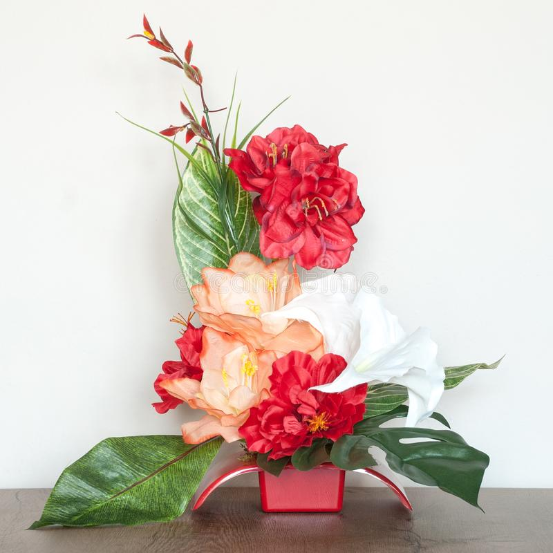 Beautiful Floral Composition with Artificial Flowers. royalty free stock photography