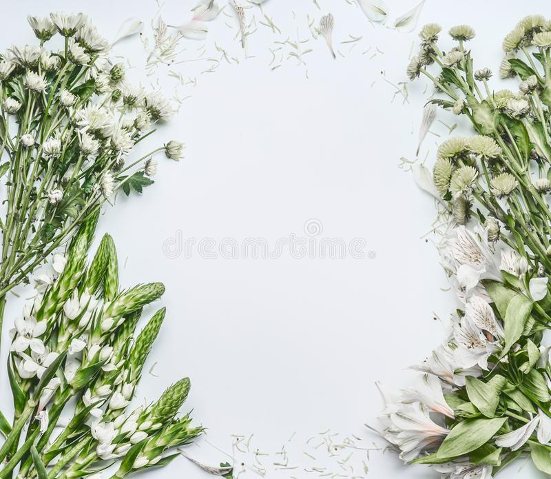 Beautiful floral frame layout with green flowers for bouquet making on white background royalty free stock image
