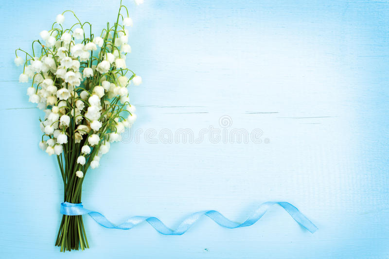 Beautiful floral frame with lilies of the valley flowers on table stock photography