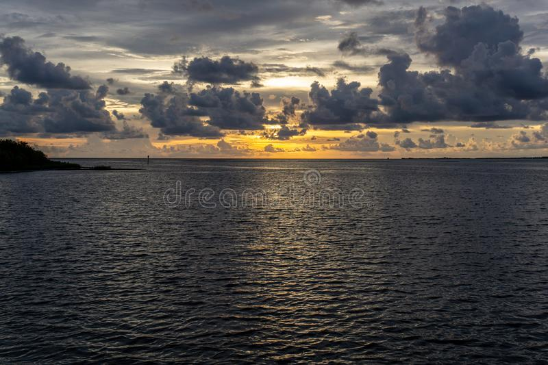 Beautiful Florida gulf coast sunset after an evening thunderstorm. A beautiful Florida gulf coast sunset after an evening thunderstorm has passed through the stock photo