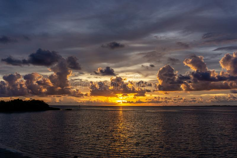 Beautiful Florida gulf coast sunset after an evening thunderstorm. A beautiful Florida gulf coast sunset after an evening thunderstorm has passed through the royalty free stock photos