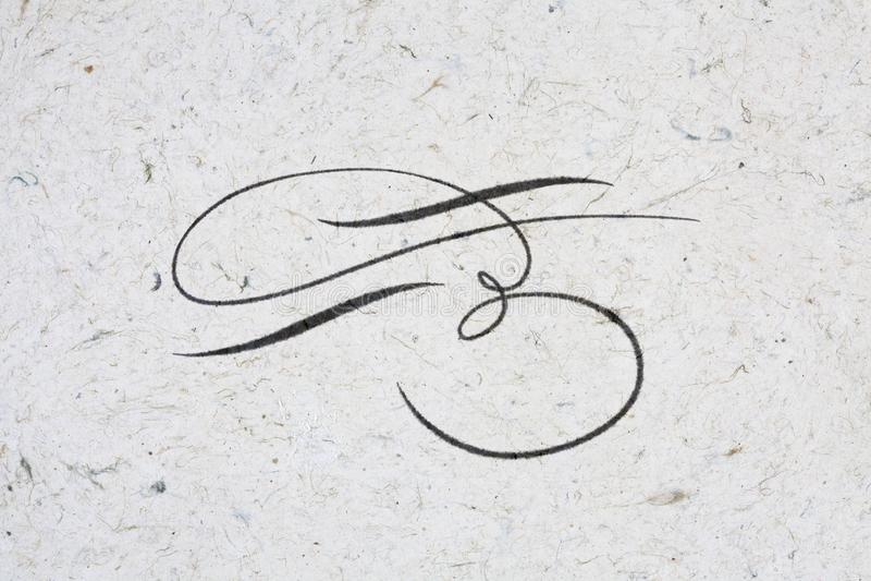 Flourish written in ink. Beautiful flourish written in ink on kraft paper royalty free illustration