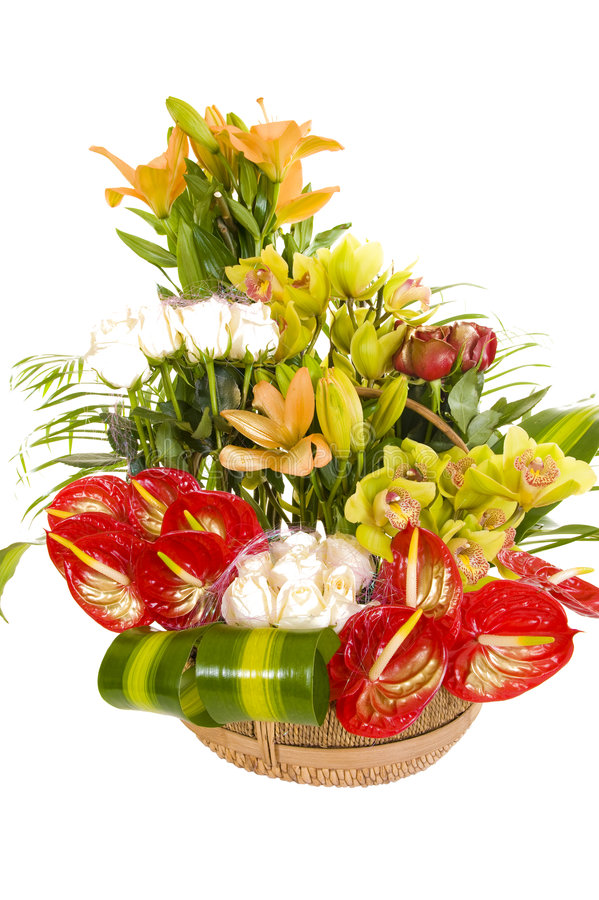 Beautiful flower arrangement. A beautiful flower arrangement consisting of various types of colorful flowers and other pieces of decoration, isolated on white royalty free stock photos