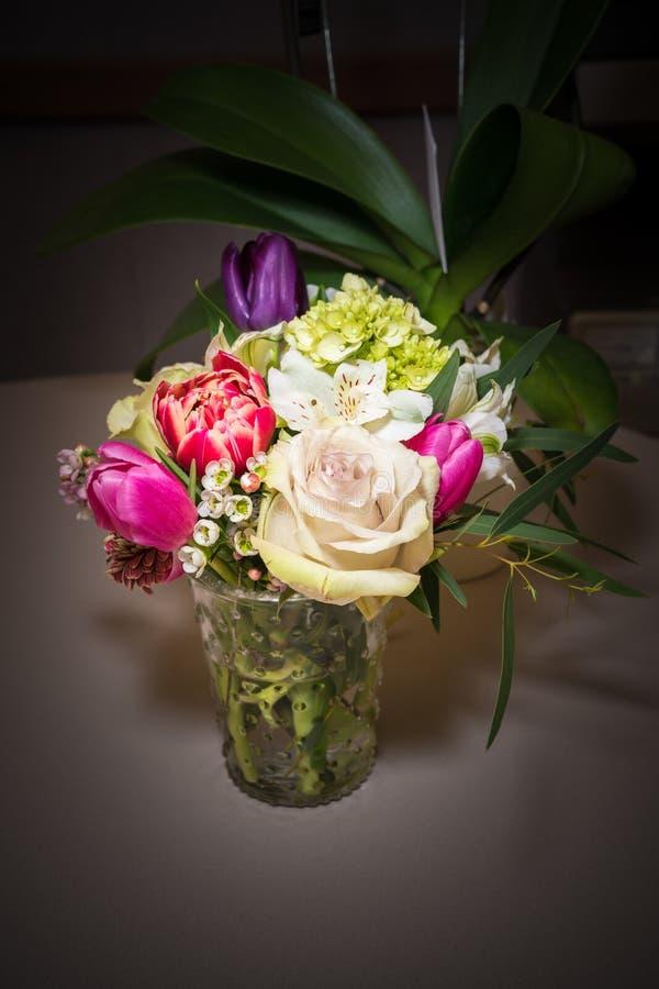 Beautiful flower arrangement in glass vase stock photo