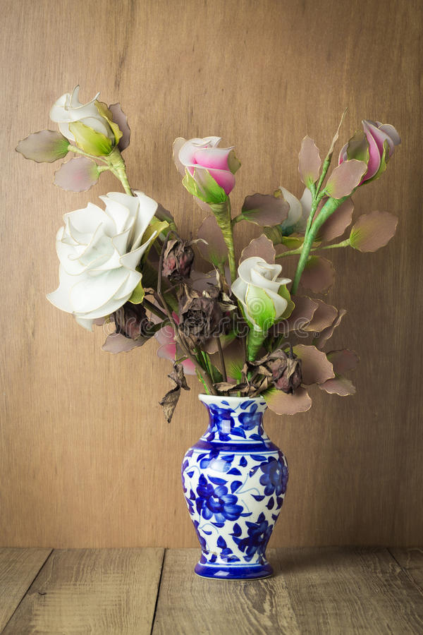 Beautiful flower in blue vase still life on wood background stock photography