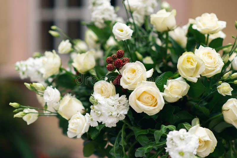 Beautiful flower decorations for the wedding ceremony. White roses decor stock photo