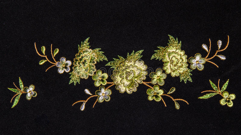 Beautiful flower embroider. On black background stock photo