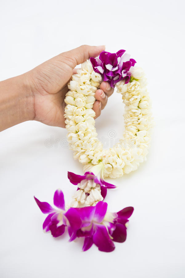 Beautiful flower garland in hand stock photography