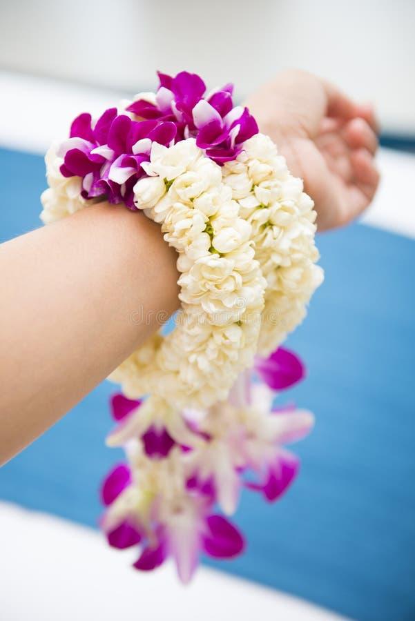 Beautiful flower garland in hand stock photos