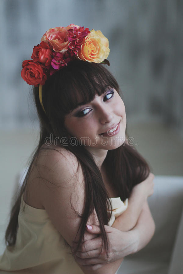 Beautiful flower girl. Portrait of a beautiful flower girl royalty free stock photography