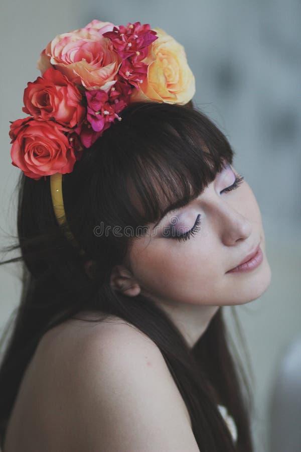 Beautiful flower girl. Portrait of a beautiful flower girl royalty free stock photo