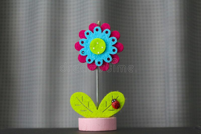 Beautiful flower handmade by colorful felt fabrics royalty free stock photo