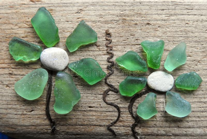 Beautiful flower made from natural sea glass and sea wood, Lithuania stock photos
