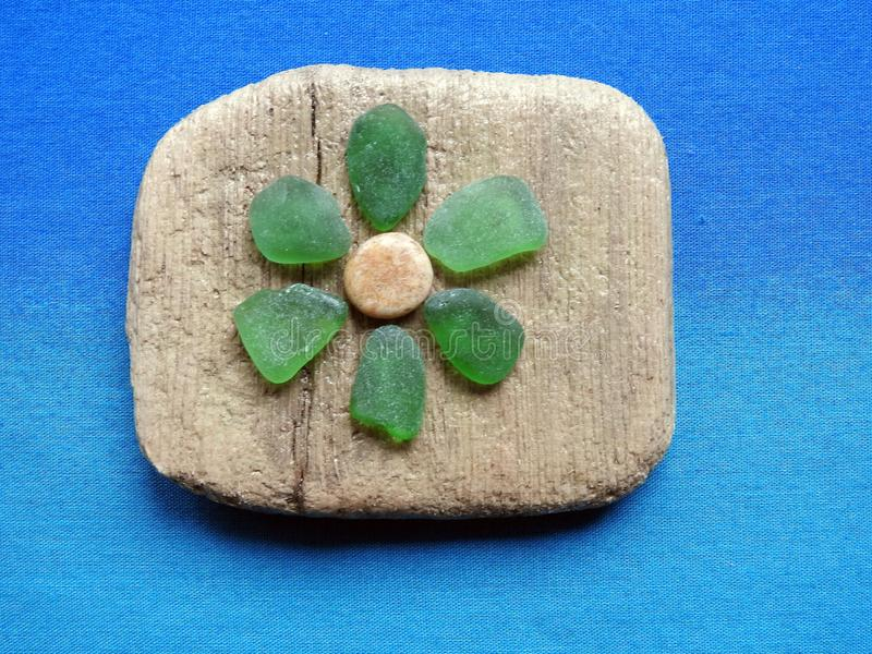 Beautiful flower made from natural sea glass and sea wood, Lithuania stock photography