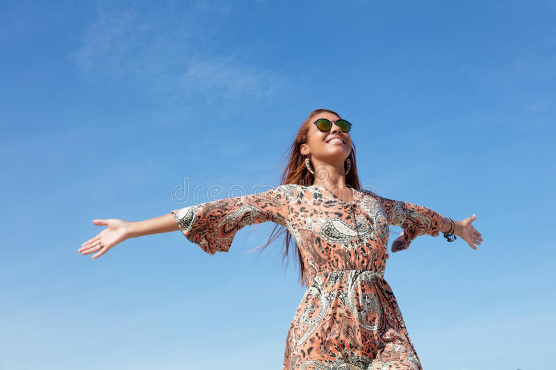 Beautiful flower power woman with copy space in blue sky outdoor stock images