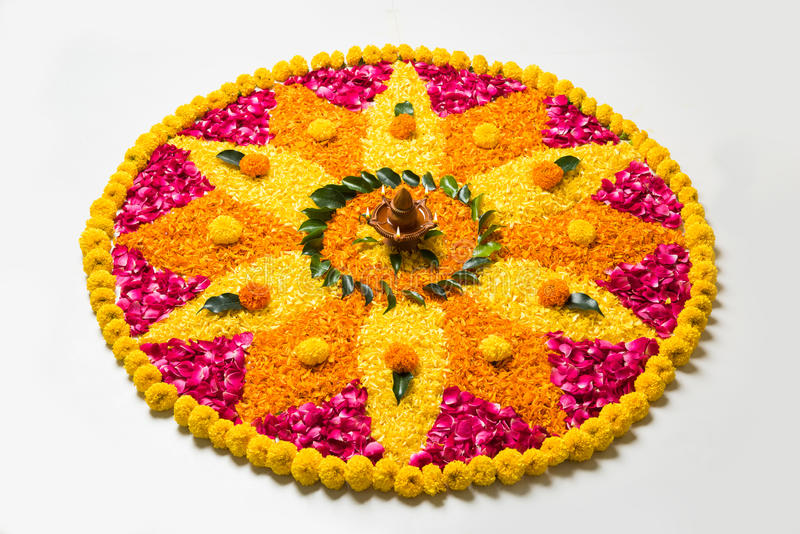 Beautiful Flower rangoli or decoration with clay lamp for diwali or any indian festival royalty free stock photo