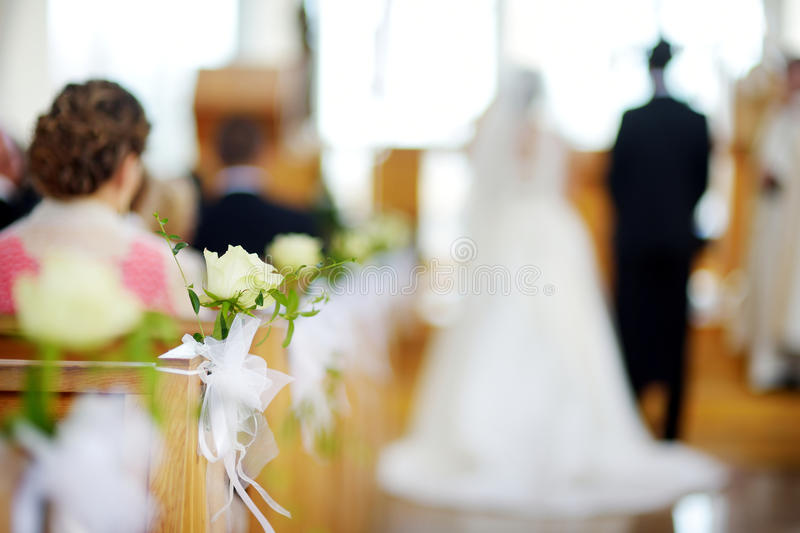 Beautiful flower wedding decoration in a church during wedding ceremony stock photography