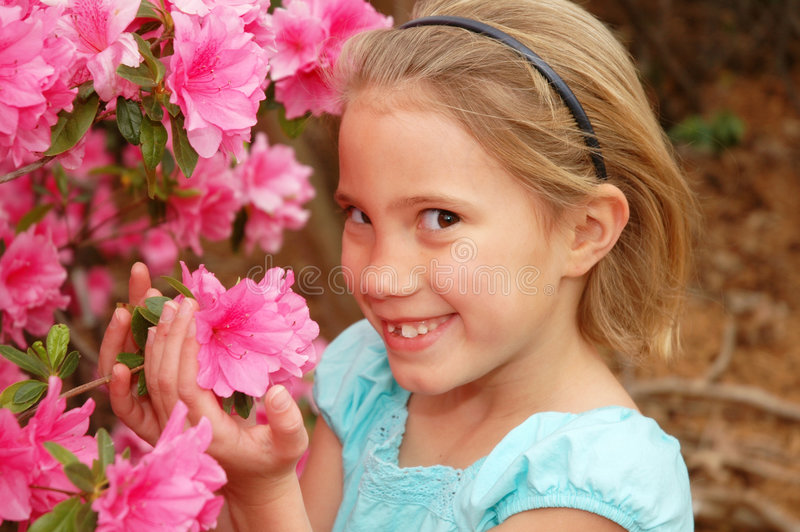 Beautiful Flowers. Little girl loves smelling these pink flowers. Springtime is here stock photos