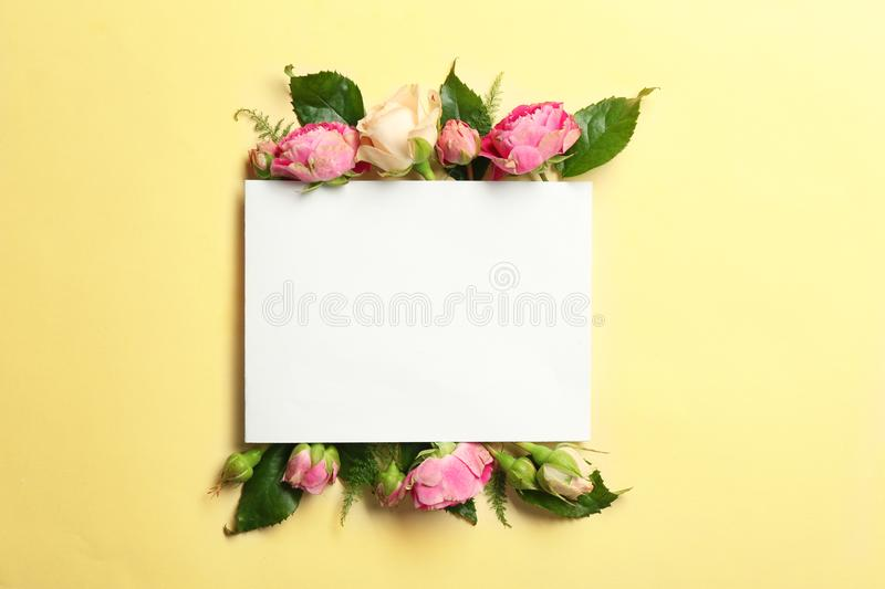 Beautiful flowers and green leaves as floral frame and paper card stock photos