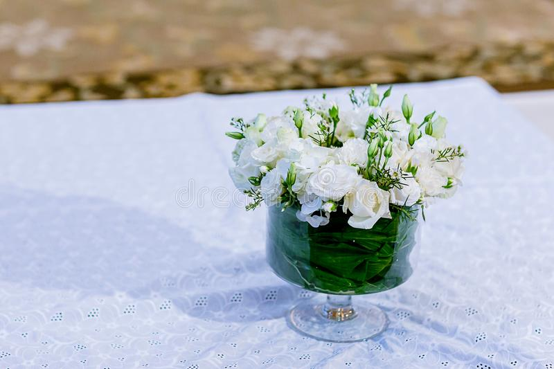 Beautiful flowers in vases on table close up. stock photos