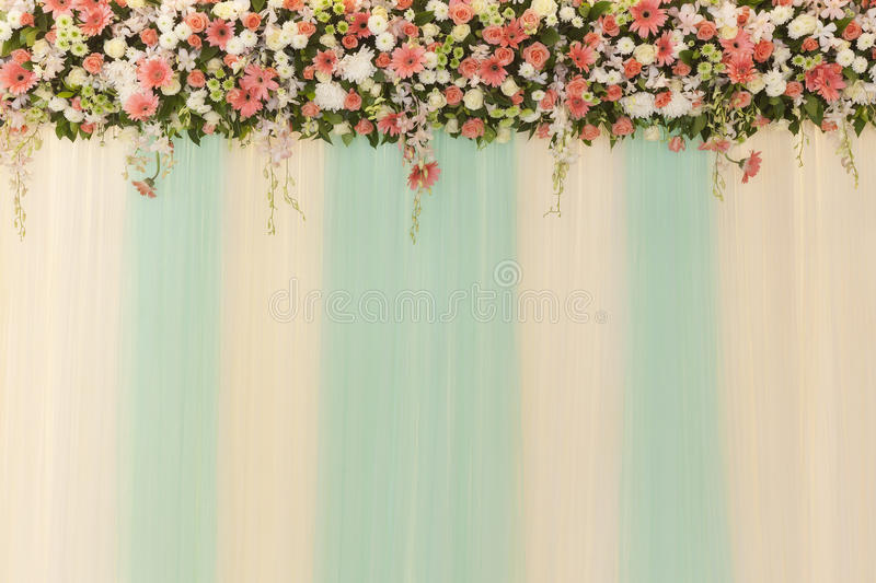 Beautiful flowers and wave curtain wall background - Wedding cer. Emony scene royalty free stock photos