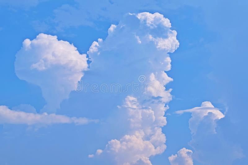 Beautiful fluffy clouds. Beautiful fluffy clouds in the blue sky royalty free stock image