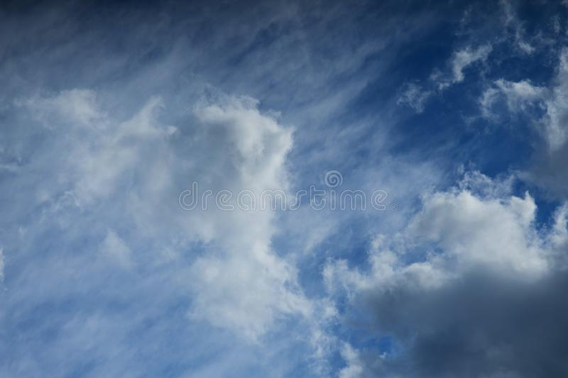 Beautiful fluffy white clouds against the blue sky stock images