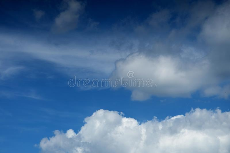 Beautiful fluffy white clouds against the blue sky stock photo