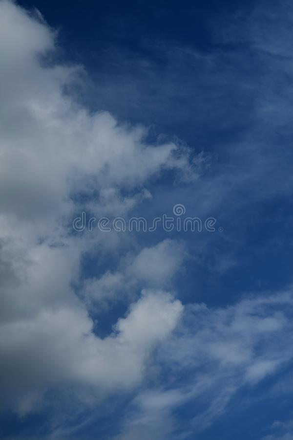 Beautiful fluffy white clouds against the blue sky royalty free stock images