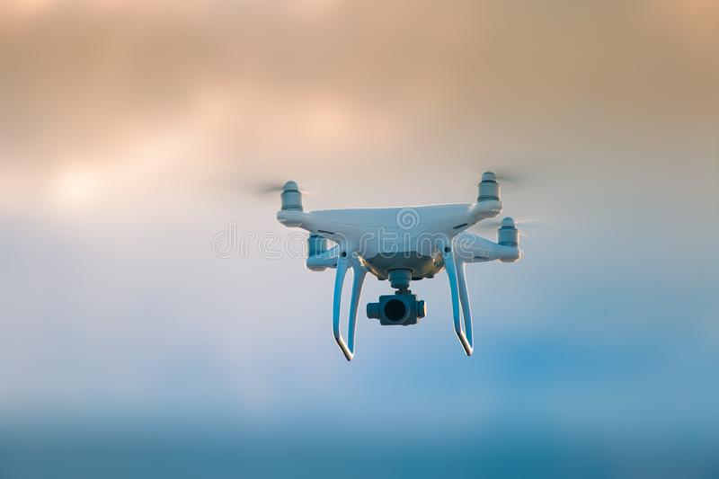 A beautiful flying drone in the evening skies. Aero photography in action. stock photo