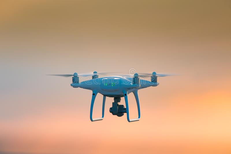A beautiful flying drone in the evening skies. Aero photography in action. stock photography