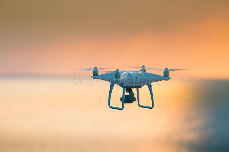 A beautiful flying drone in the evening skies. Aero photography in action. royalty free stock photography