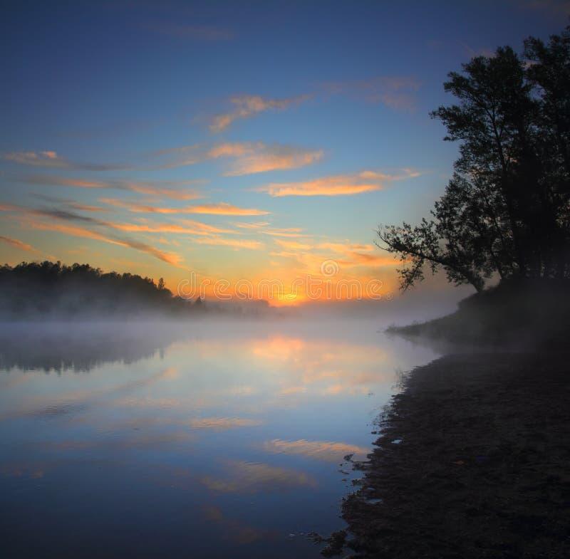 Beautiful fog sunrise on river stock image