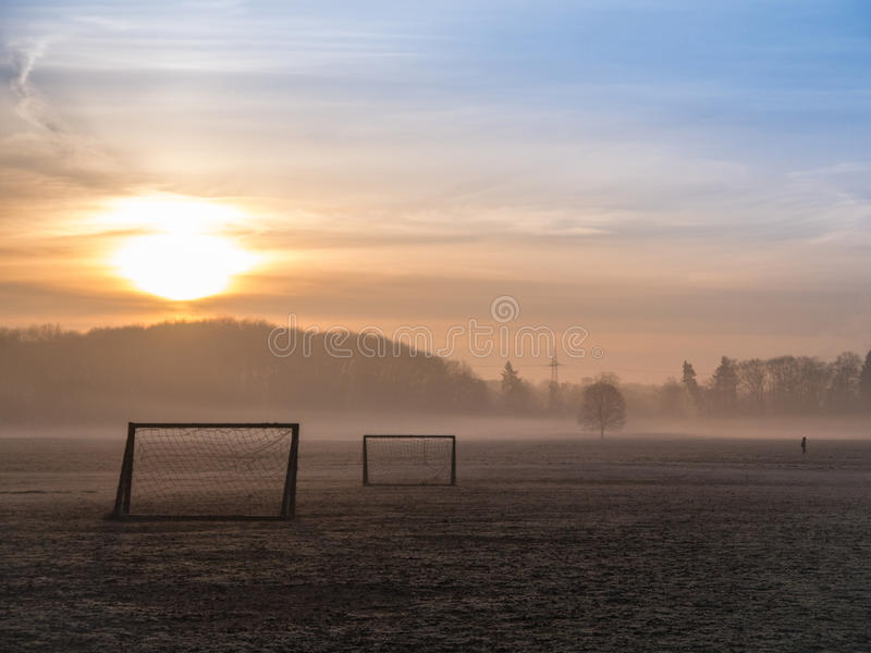 Beautiful foggy soccer pitch royalty free stock photos