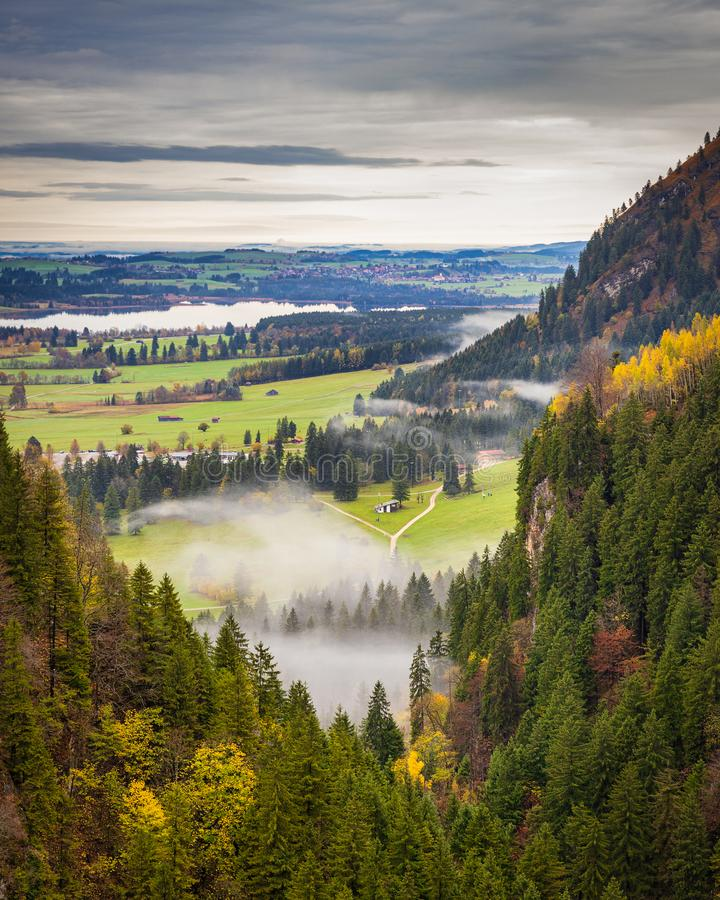 Beautiful foggy valley view in autumn in Bavaria, Germany. Beautiful foggy valley view in autumn in Bavaria region, Germany royalty free stock photos