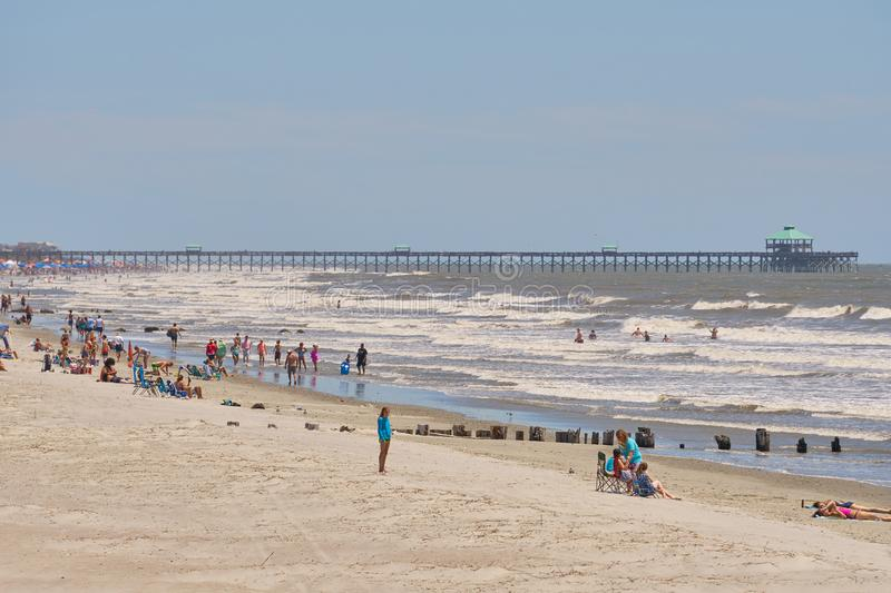 Beautiful Folly Beach, SC with pier in backgroun stock photography
