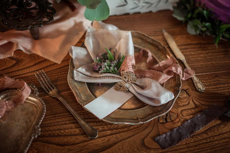 Beautiful food photo props, amazing table serving with fresh flowers, silver dish, knife and fork stock photos