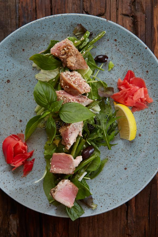 Beautiful food: steak tuna in sesame, lime and fresh salad close-up on a plate on the table. Beautiful food: steak tuna in sesame, lime and fresh salad close-up stock images