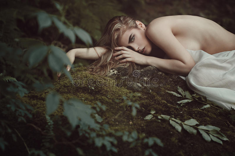Beautiful forest maiden in Mother nature peace stock photo