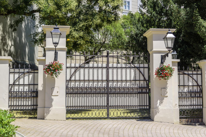 Beautiful forged gates with stone columns. royalty free stock images