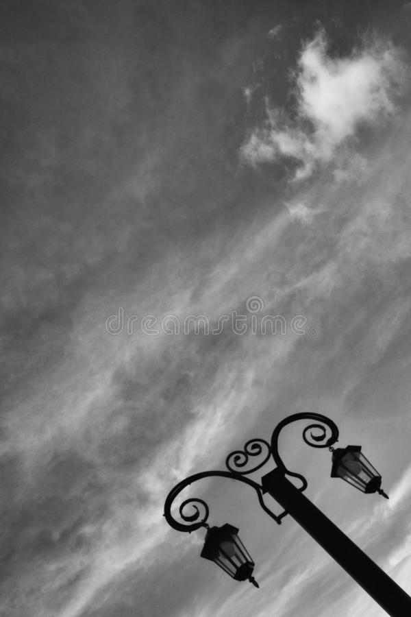 Beautiful forged vintage lantern against the sky. in black and white. stock image