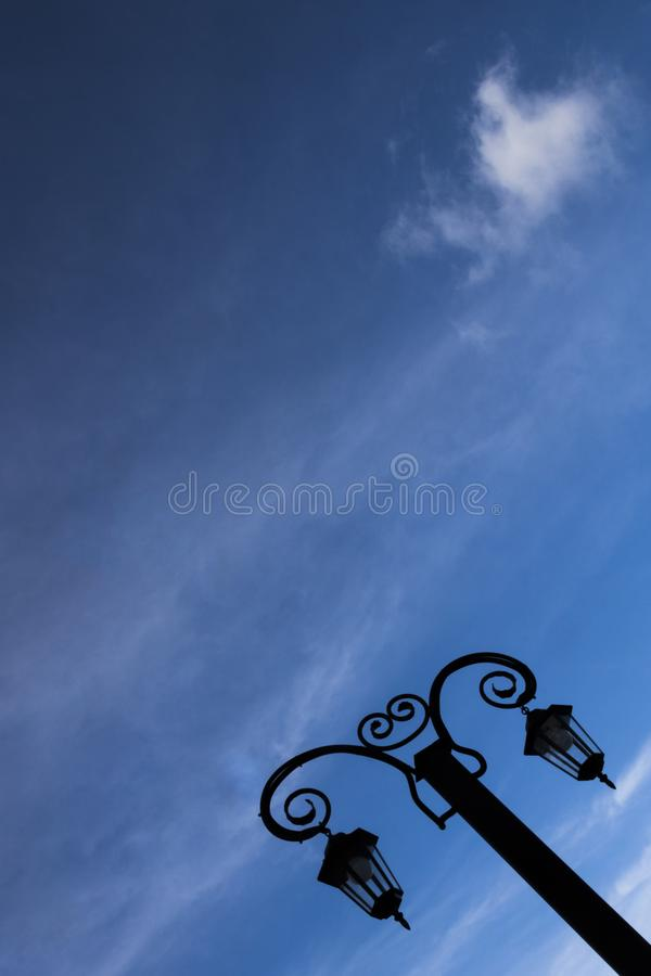 Beautiful forged vintage lantern against the sky stock photos